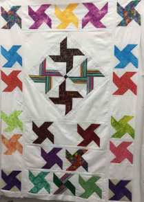 Blocks of the Month made into a quilt top by Linda P.